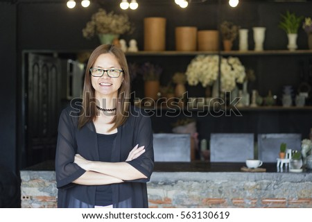 Successful small business owner standing In Coffee Shop