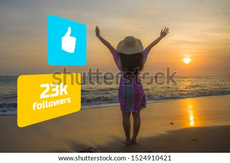 Successful social media influencer girl in Summer hat enjoying sunset in paradise beach . young happy woman feeling free getting likes and followers in holiday travel blog success #1524910421
