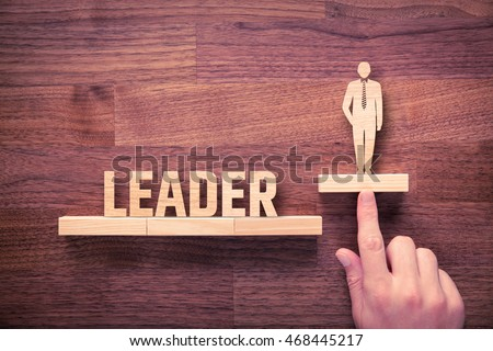 Successful team leader (manager, CEO, market leader) and another business leading concepts. Standing out from the crowd. #468445217