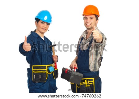 Successful team of constructor workers giving thumbs up isolated on white background