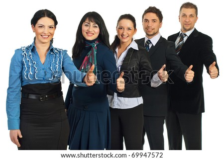 Successful team of five business people standing in a row and giving thumbs up isolated on white background