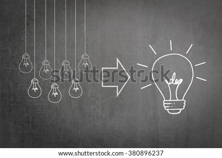 Successful team work brainstorm concept of strategic planning and synergy collaboration of good teamwork leader with big creative idea lightbulb thought on business chalkboard or teacher's blackboard
