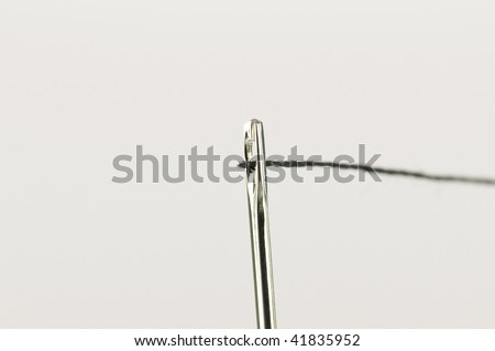 Successful thread through needle pin head opening