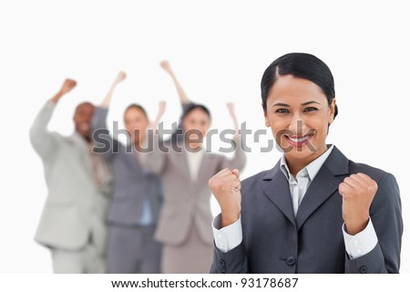 Successful tradeswoman with cheering colleagues behind her against a white background