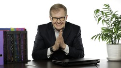 Successful tricky businessman manager winning project successful work rubbing hands satisfied working at office table. Business people. Copy space. Guy in suit, shirt, glasses. White background