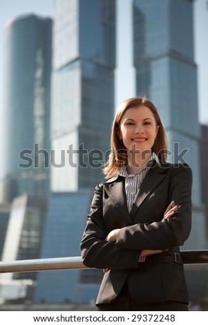 Successful woman among the business center