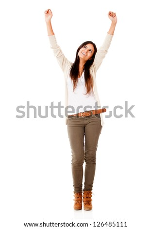 Successful woman celebrating with arms up - isolated over white