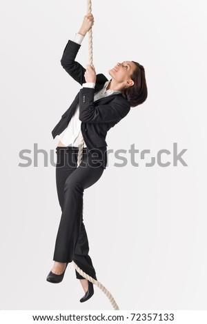Successful woman climbing up to career