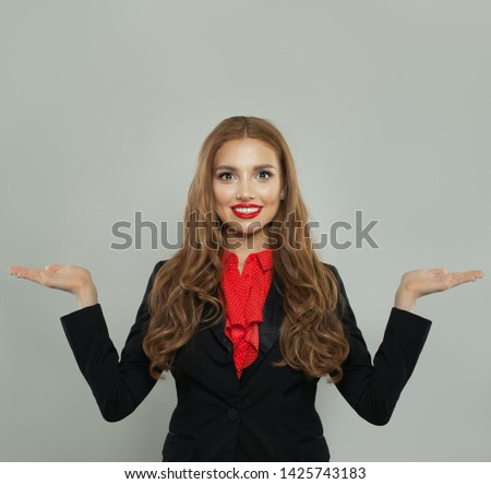 Successful woman holding two empty open hand on white background. Rate, weigh and represent #1425743183