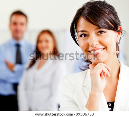Successful woman leading a business team looking confident