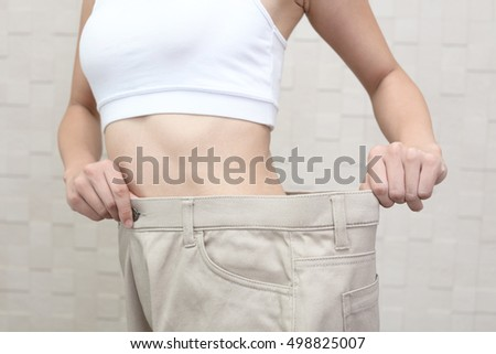 Successful woman on diet #498825007