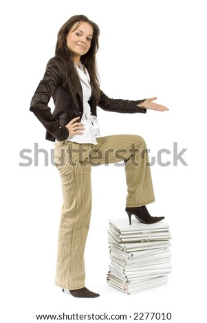 successful woman standing on the pile of files (white background)