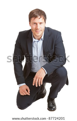 Successful young business man smiling into camera isolated on white background