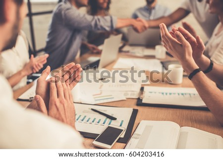 Successful young business people are applauding during the conference #604203416