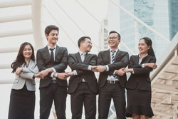 Successful young business people are raising hands and screaming with happiness, complete finish job, teamwork successful/achievement working Successful entrepreneurs & business people achieving goal