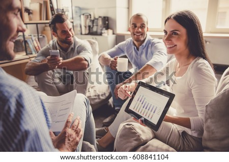 Successful young business people are sharing ideas and smiling during the coffee break - Shutterstock ID 608841104