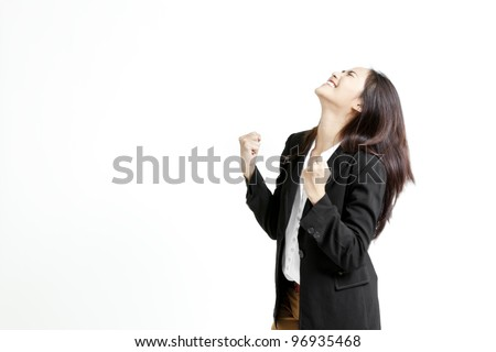 Successful young business woman happy for her success. - stock photo