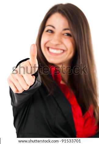 Successful young business woman showing thumbs up sign