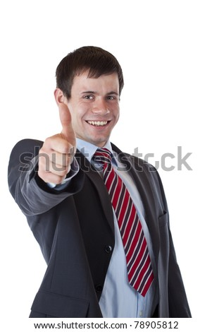 Successful young businessman is pleased holding thumb up. Isolated on white background.