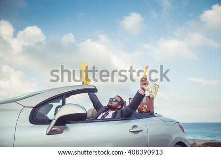 Successful young businessman on a beach. Man sitting in the cabriolet classic car. Summer vacations and travel concept #408390913