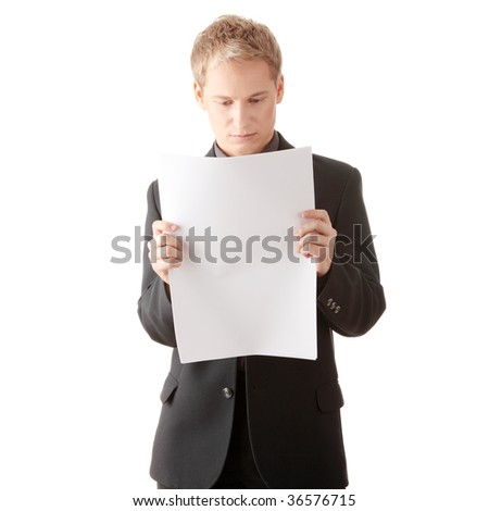 Successful young businessman reading blank card (newspaper) in studio
