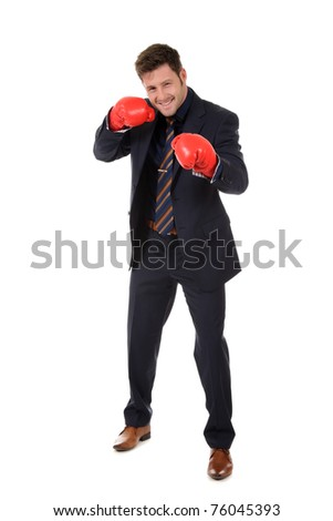 Successful young caucasian businessman wearing boxing gloves. Left hand short punch. Studio shot. White background.