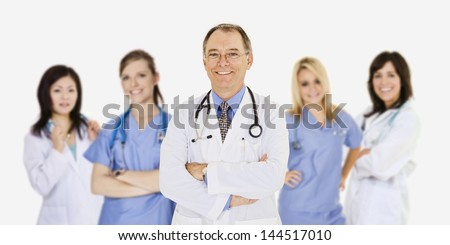 Successful young doctors smiling over a white background - stock photo