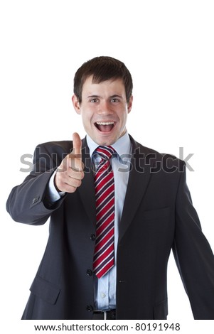Successful young entrepreneur holds thumb up happy.Isolated on white background.
