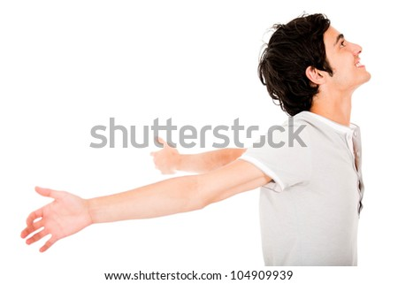 Successful young man with arms open - isolated over a white background