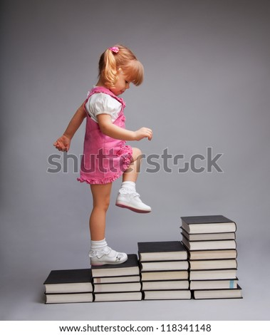 Successfully going from one education level to another - girl going up the stairs of books