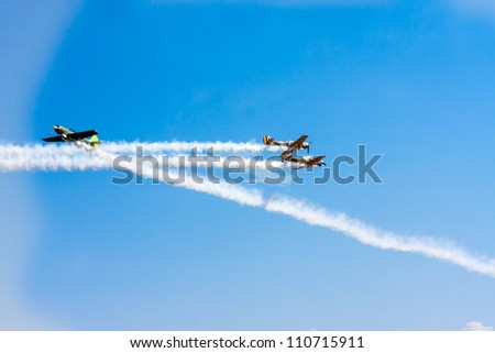 SUCEAVA,ROMANIA - AUGUST 04 :Romanian Aerobatic Team (Iacarii Acrobati) and Jurgis Kairys  perform at Suceava airshow on August 04, 2012 in Suceava, Romania