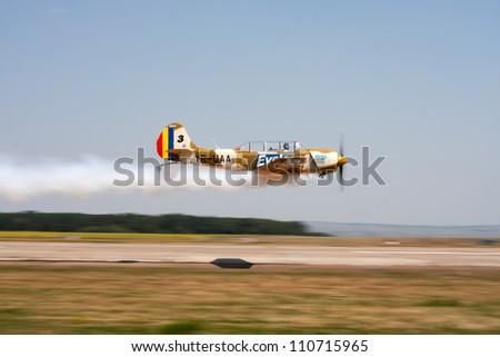 SUCEAVA,ROMANIA - AUGUST 04 :Romanian Aerobatic Team (Iacarii Acrobati) and Jurgis Kairys  perform at Suceava airshow on August 04, 2012 in Suceava, Romania