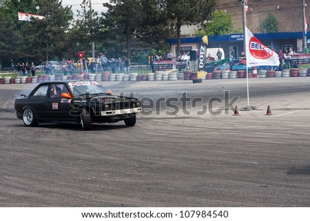 SUCEAVA, ROMANIA - MAY 26:Unknown driver performs a drifting demonstration at Third stage of the National Drift Championship, Toyota Suceava Drift Series ,May 26, 2012, Suceava, Romania