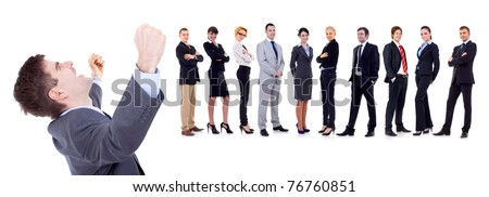 Sucessful business man on white background with business team behind
