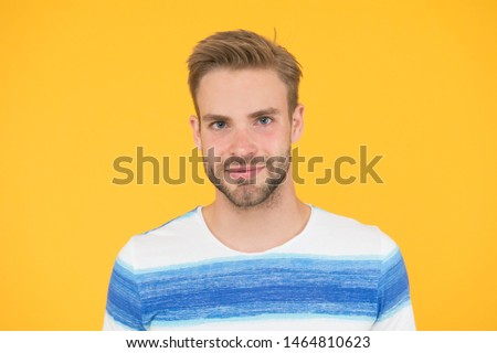 Such a handsome guy. Handsome man on yellow background. Caucasian male model with unshaven handsome face and stylish blond hair. Casual and handsome. #1464810623