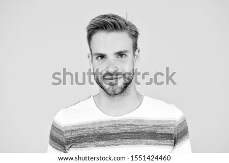 Such a handsome guy. Handsome man on yellow background. Caucasian male model with unshaven handsome face and stylish blond hair. Casual and handsome.