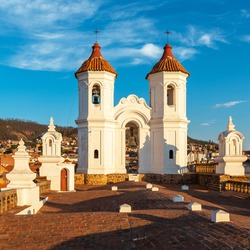 Sucre city sunset from San Felipe Neri church monastery with clock towers, Sucre Department, Bolivia.