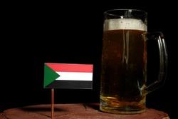Sudanese flag with beer mug isolated on black background