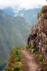 Sudden break of a narrow path at Machu Picchu, Peru