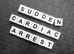 Sudden Cardiac Arrest, word cube with background.