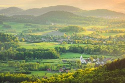 Sudetes, Lower Silesia Poland. Rural landscape made with telephoto lens on sunset