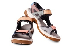 Suede sandals, velcro straps, flat sole white background isolated close up, trekking sandal shoes, pair of nubuck leather sport footwear, two summer colorful walking boots, casual comfortable footgear