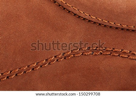 Suede surface of a boot with stitches