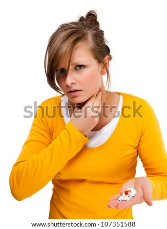 Suffering woman holding pills isolated on white background