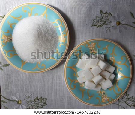 Sugar - A product made from sugar beets. In the photo, refined sugar and granulated sugar.