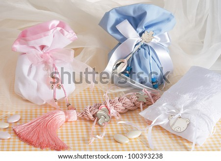 sugar almonds in the  pouch with sweets for christening of boys and girls on a beautiful composition