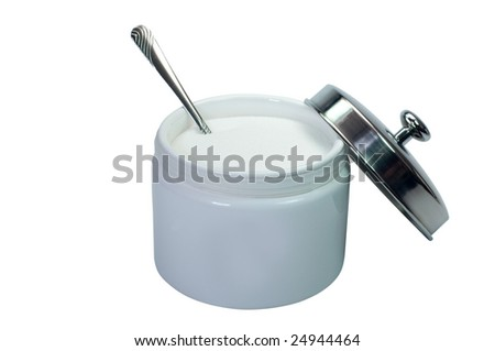 Sugar and spoon in bowl.  Isolated on white background with clipping path.