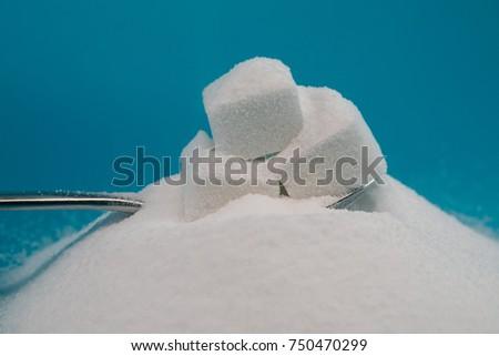 Sugar and sugar lumps on a tea spoon #750470299