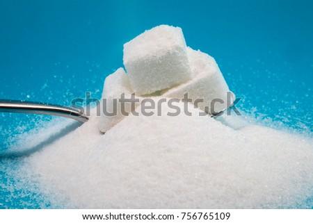 Sugar and sugar lumps on a tea spoon #756765109