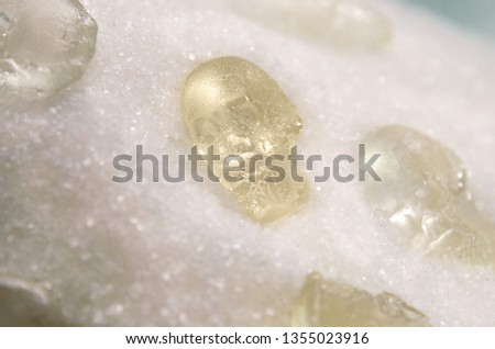 Sugar background. Granulated sugar with skulls from sugar. Harm of eating sugar concept. Sweet leads to diabetes.